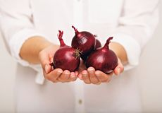 Woman Showing Red Onions royalty free stock image