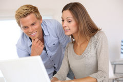 Woman showing result on computer to colleague Royalty Free Stock Image