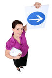 Woman showing road sign Royalty Free Stock Photos
