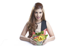 Woman showing salad for Healthy. Woman show & eating salad. Portrait of beautiful smiling and happy mixed Asian brunette  woman enjoying a healthy salad and Royalty Free Stock Photo