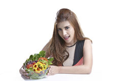 Woman showing salad for Healthy. Woman show & eating salad. Portrait of beautiful smiling and happy mixed Asian brunette  woman enjoying a healthy salad and Royalty Free Stock Image