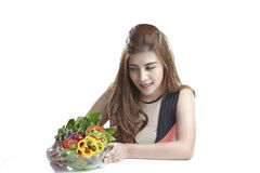Woman showing salad for Healthy. Woman show & eating salad. Portrait of beautiful smiling and happy mixed Asian brunette  woman enjoying a healthy salad and Stock Image