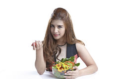 Woman showing salad for Healthy. Woman show & eating salad. Portrait of beautiful smiling and happy mixed Asian brunette  woman enjoying a healthy salad and Royalty Free Stock Images