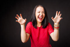 Woman showing scary face Royalty Free Stock Photos