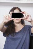 Woman showing screen smartphone Stock Photography