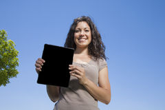 Woman showing screen tablet Royalty Free Stock Image