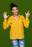 Woman showing seven fingers Royalty Free Stock Photos