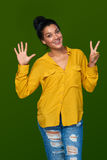 Woman showing seven fingers Stock Photo