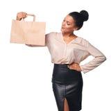 Woman showing shopping bag Royalty Free Stock Photo