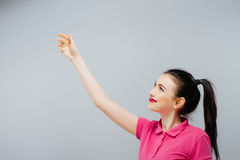 Woman showing sign looking happy excited. Advertisement.  Royalty Free Stock Image