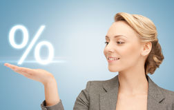 Woman showing sign of percent in her hand Royalty Free Stock Images