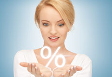 Woman showing sign of percent in her hands. Beautiful woman showing sign of percent in her hands Royalty Free Stock Images