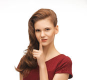 Woman showing silence gesture Stock Photography