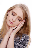 Woman showing sleeping gesture Royalty Free Stock Photo