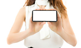 Woman showing smart phone with copy space Royalty Free Stock Photography