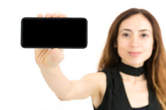 Woman showing smart phone with copy space Stock Photos