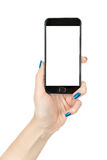 Woman showing smart phone with isolated screen Royalty Free Stock Images