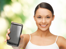 Woman showing smartphone Stock Image