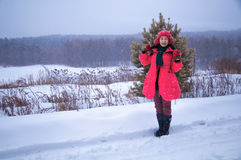Woman showing in snow Stock Photo