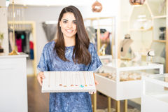 Woman showing some jewelry at a shop Stock Photos