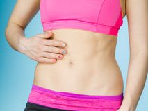 Woman showing some strong abs and flat belly Stock Image