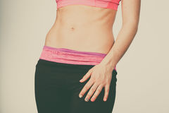 Woman showing some strong abs and flat belly Stock Photos
