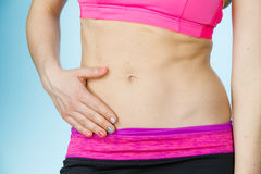 Woman showing some strong abs and flat belly Royalty Free Stock Photo