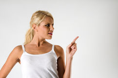 Woman showing something Stock Photos