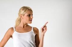 Woman showing something Stock Photos