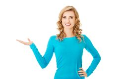 Woman showing something or copyspase Stock Photo