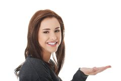 Woman showing something or copyspase Stock Image