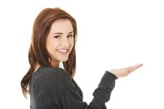 Woman showing something or copyspase Stock Photography