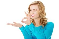 Woman showing something or copyspase Royalty Free Stock Photo