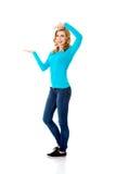 Woman showing something or copyspase Stock Photos