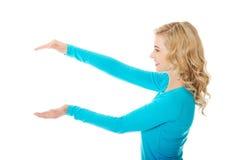 Woman showing something or copyspase Stock Images
