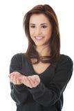 Woman showing something or copyspase Stock Photo