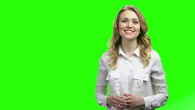 Woman showing something on green screen.