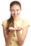 Woman showing something on her palms Royalty Free Stock Photography