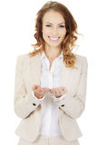 Woman showing something on palms Stock Images