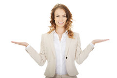 Woman showing something on palms Royalty Free Stock Images