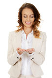 Woman showing something on palms Royalty Free Stock Photo