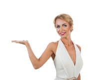 Woman showing something on the palms of her hands Royalty Free Stock Image