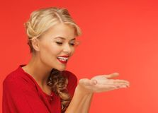 Woman showing something on the palms Royalty Free Stock Photo