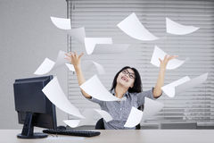 Woman showing success expression with paper Royalty Free Stock Images