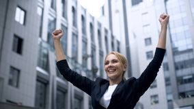 Woman showing success gesture, extremely happy about breakthrough in startup. Stock photo royalty free stock photos
