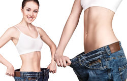 Woman showing successful weight loss Royalty Free Stock Photos
