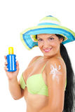 Woman showing sun protection cream Stock Photo