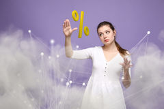 Woman showing symbol of percent. Bank Deposit or Sale concept. Stock Images
