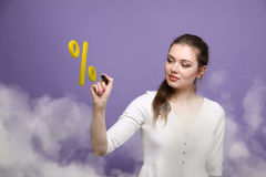Woman showing symbol of percent. Bank Deposit or Sale concept. Stock Photos