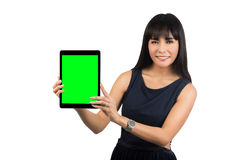 Woman showing tablet computer screen stock photos